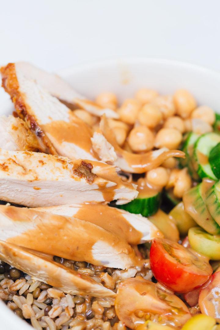 Eva Amurri Martino drizzles Annie Chun's Peanut Sauce onto a protein bowl