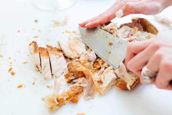 Eva Amurri Martino chops up rotisserie chicken
