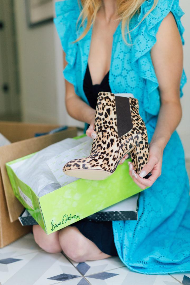 Eva Amurri Martino unpacks a pair of leopard print boots from her Amazon Prime Wardrobe
