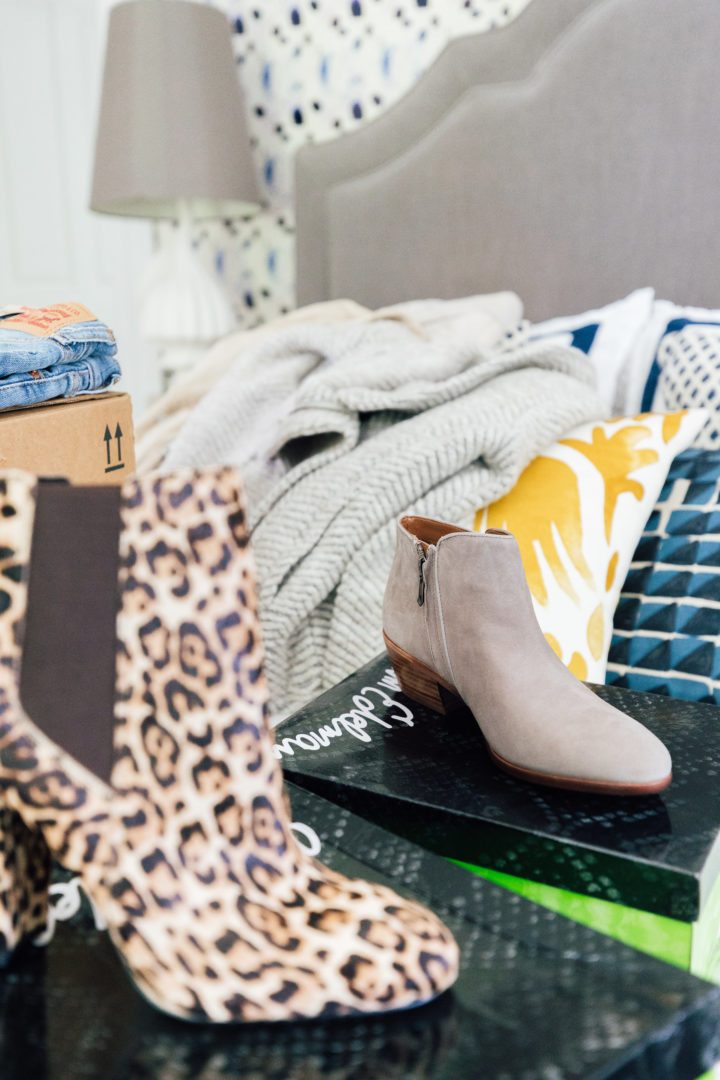 Eva Amurri Martino unpacks a pair of leopard print boots from her Amazon Prime Wardrobe