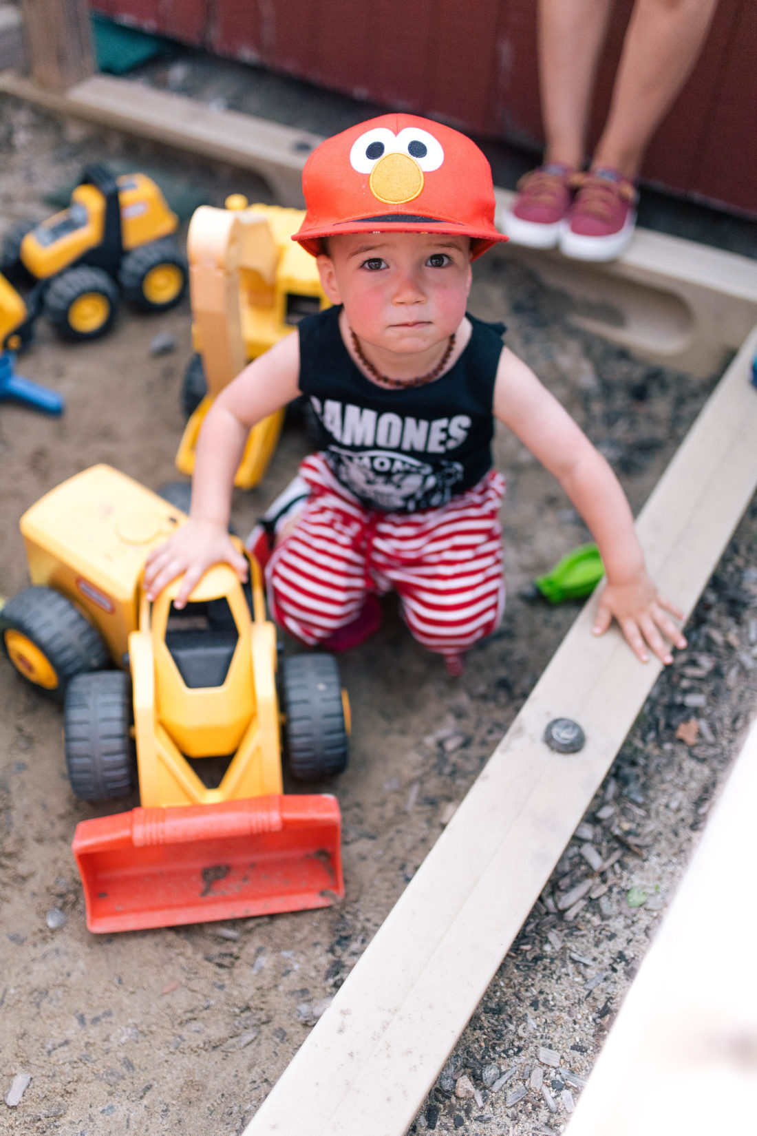 Major Martino wears an Elmo hat, and a ramones tank top, and plays in the sand at a playground in Connecticut