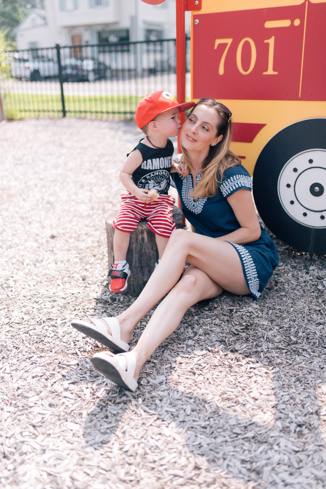 Major Martino leans in to give his Mom a kiss on the cheek at the playground