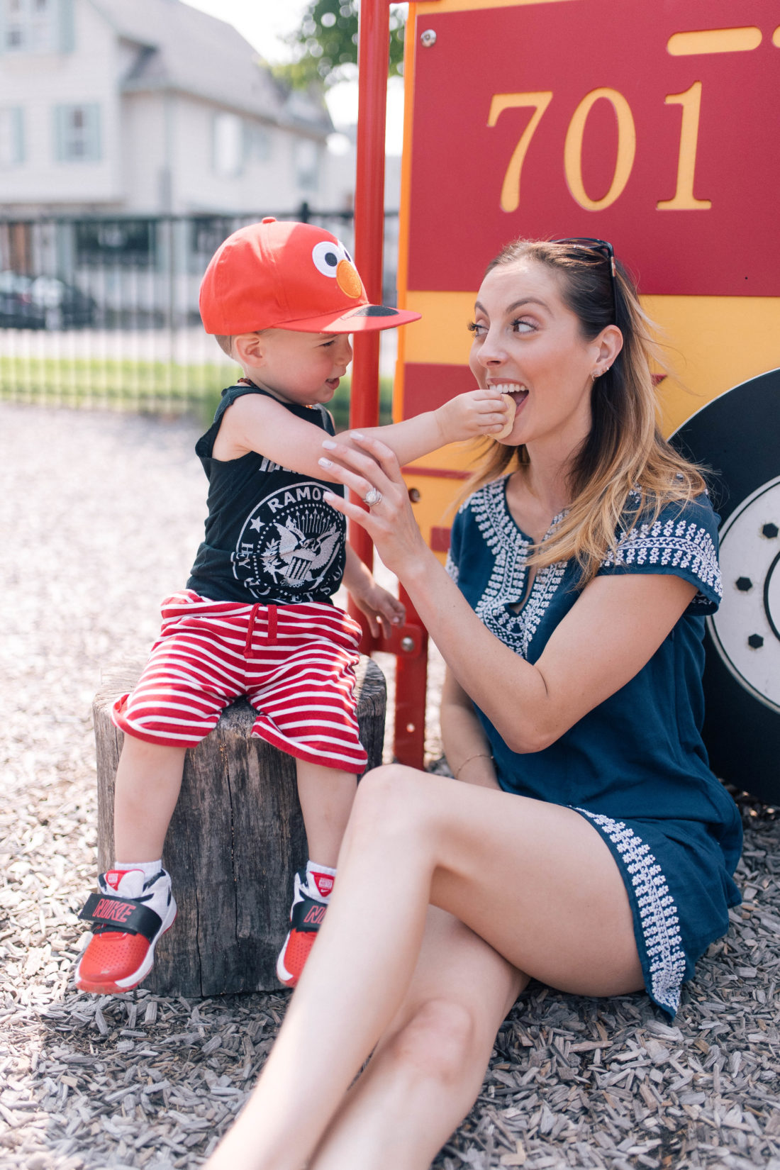 Major Martino feeds his Mom a bite of snack on the playground in Connecticut