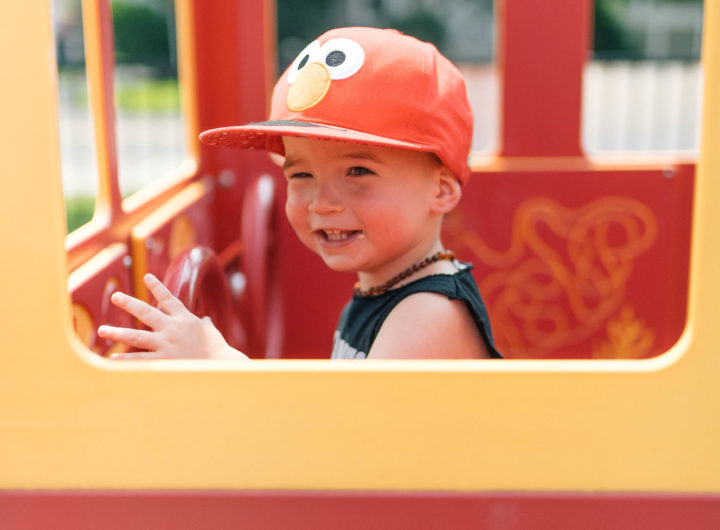 Major Martino drives in a pretend fire truck at the playground in Connecticut
