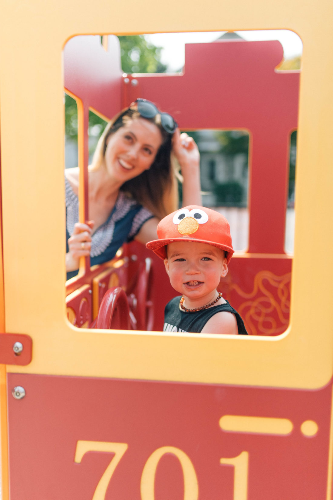 Major Martino pretends to drive a fire truck at the playground in Connecticut