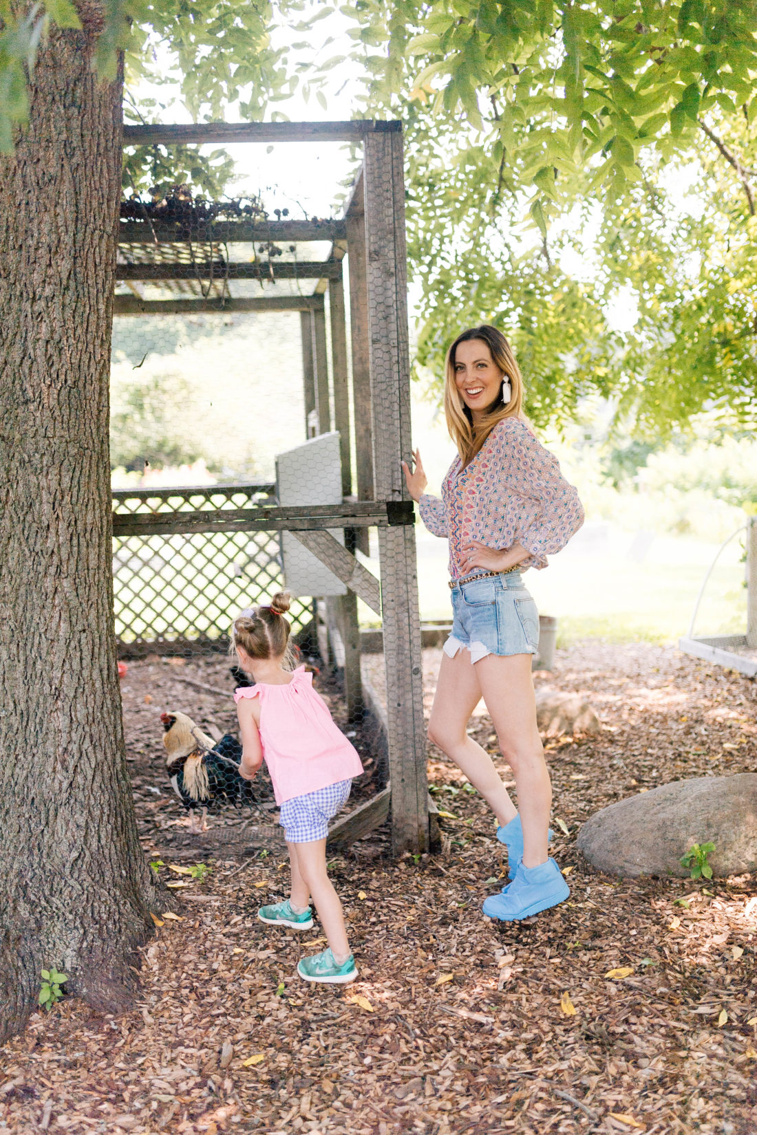 Eva Amurri Martino stands with Marlowe Martino near the chicken coop at a local Connecticut farm