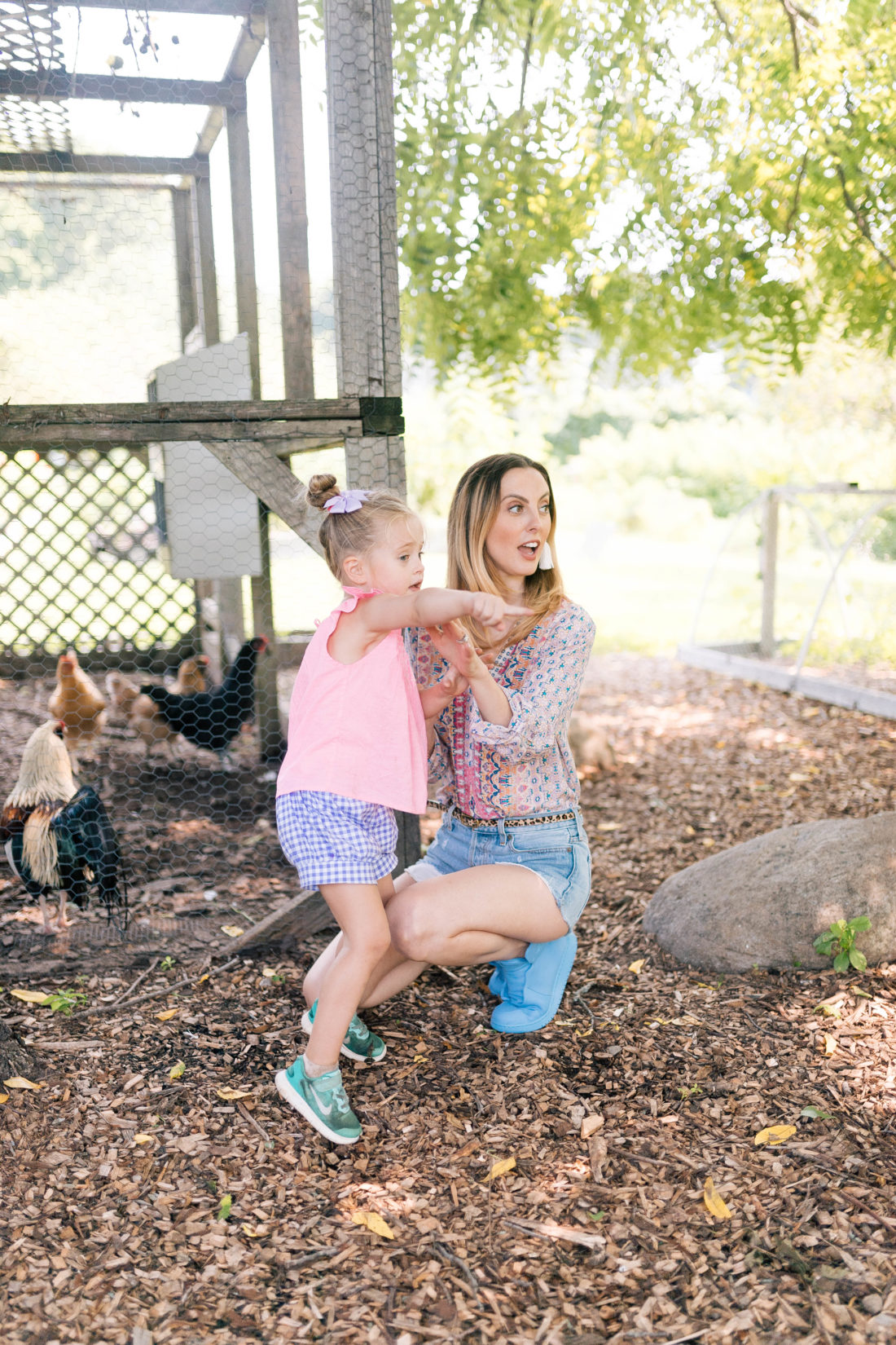 Eva Amurri Martino kneels with Marlowe Martino near the chicken coop at a local Connecticut farm