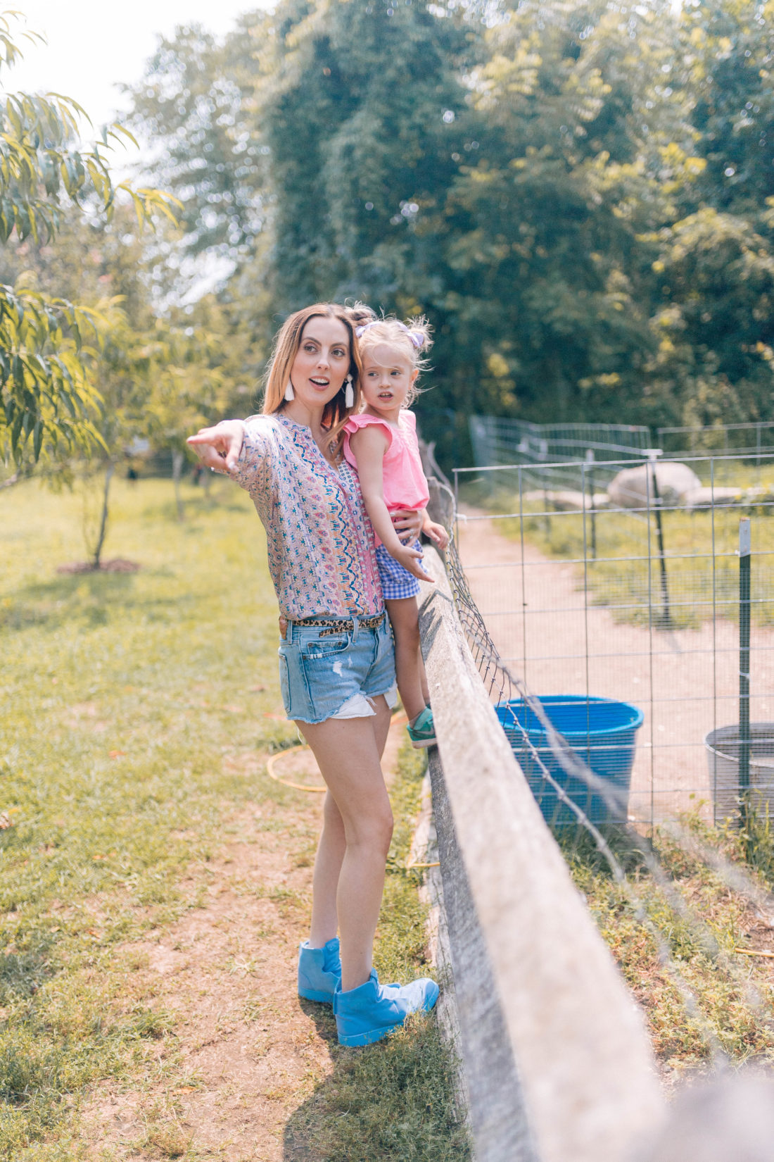 Eva Amurri Martino stands by a fence with four year old daughter Marlowe and peers in to an alpaca pen at a local connecticut farm