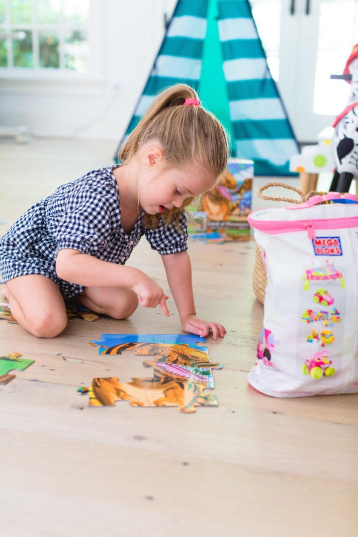 Eva Amurri Martino's daughter Marlowe plays with a dinosaur puzzle