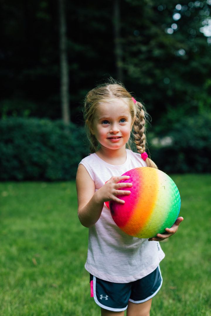 Eva Amurri Martino's daughter Marlowe plays with a ball in their backyard while her mom ponders commitment