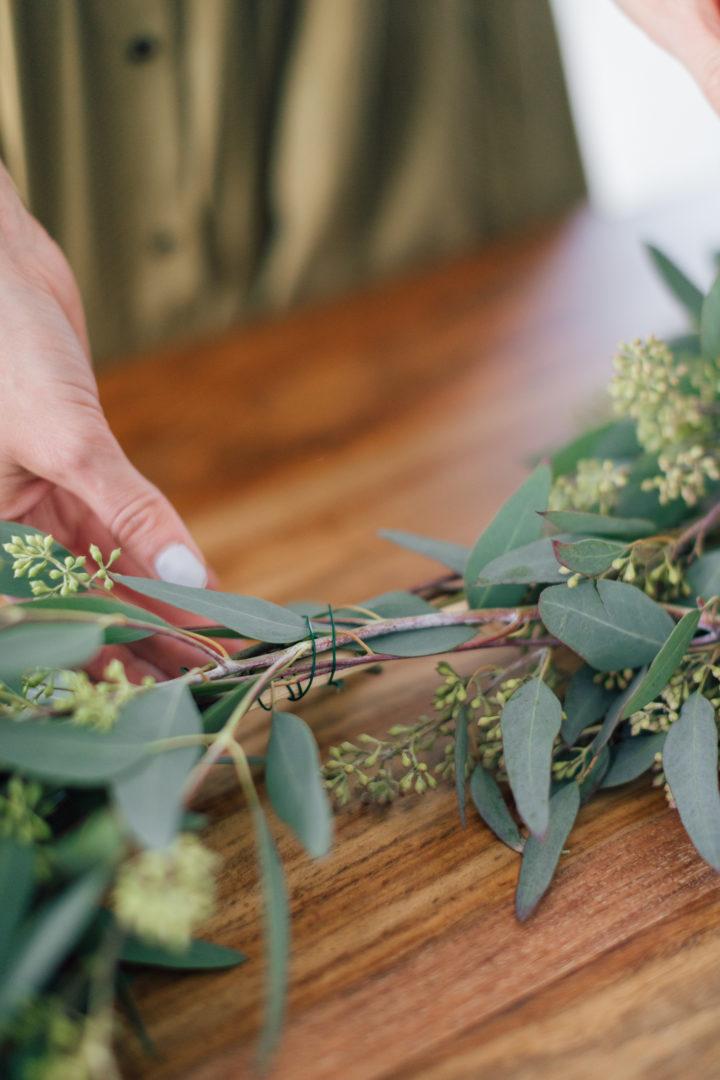 Eva Amurri Martino crafts a DIY eucalyptus garland for the holidays.
