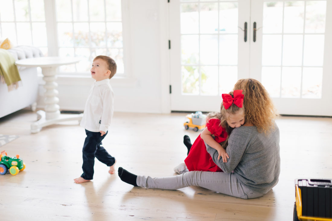 Eva Amurri Martino's two small children play with their nanny in the family room of their connecticut home