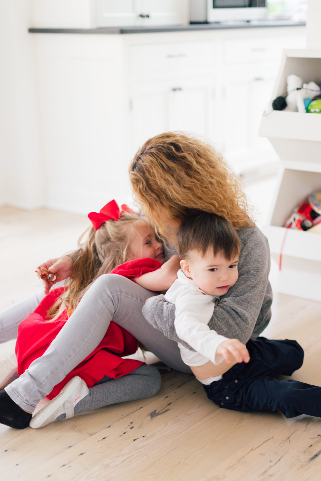 Marlowe and Major Martino snuggle their nanny in the family room of their connecticut home