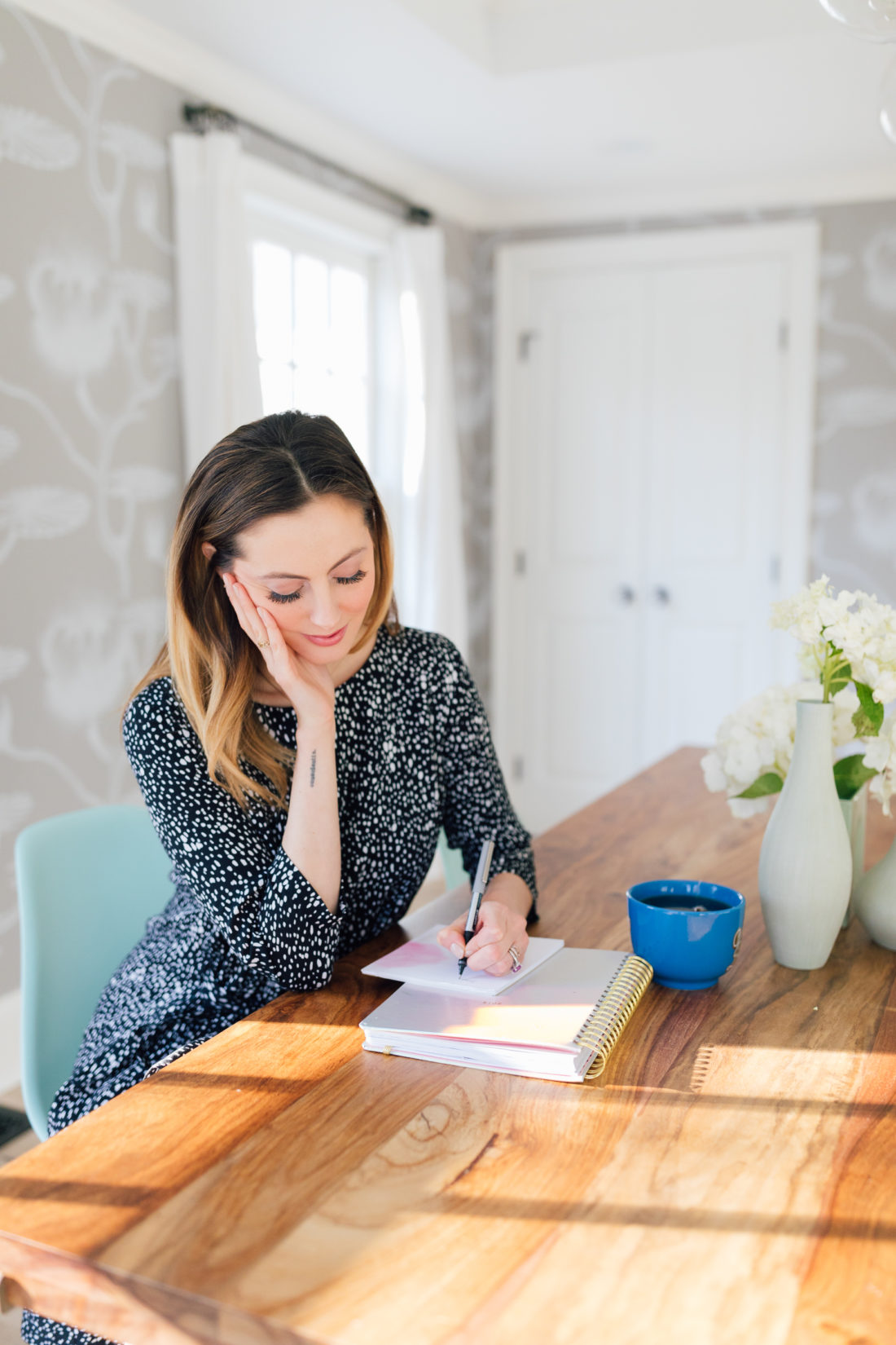 Eva Amurri Martino sits at her dining room table and writes down her intentions for the new year