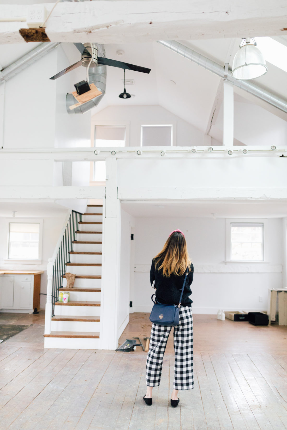 Eva Amurri Martino stands in the preliminary renovation of her new studio space in Westport Connecticut