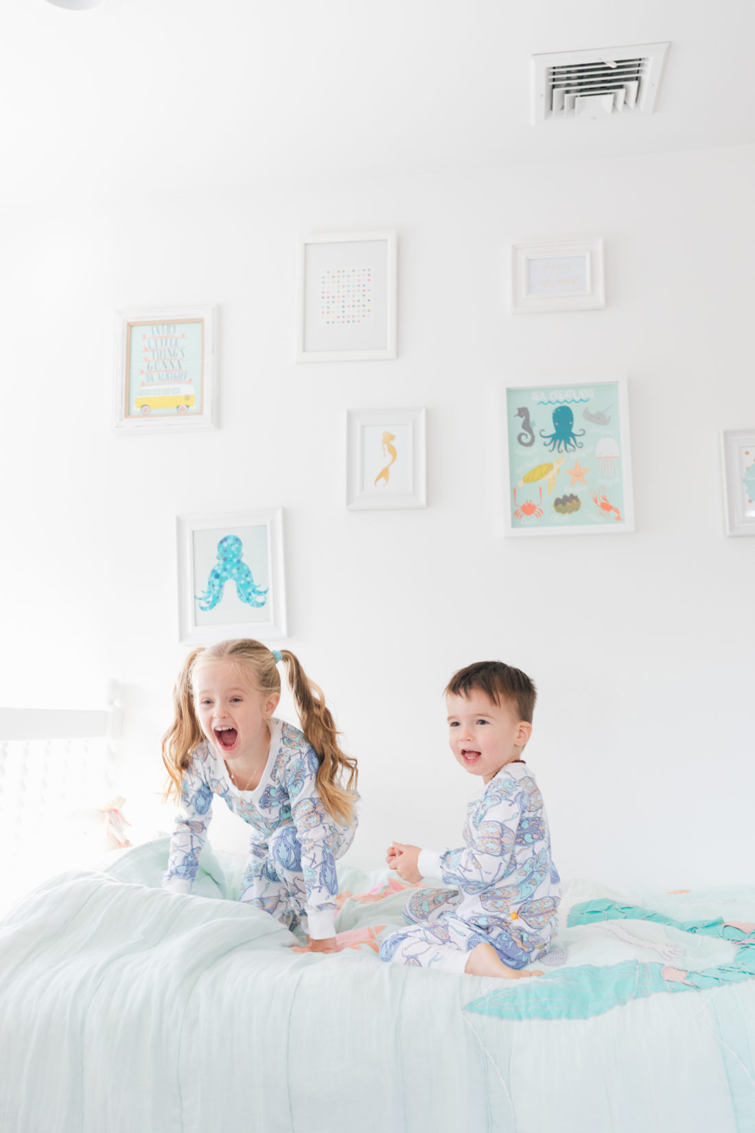 Marlowe and Major martino goof around in matching buggy pajamas from the Happily Eva After x Masala Baby capsule collection