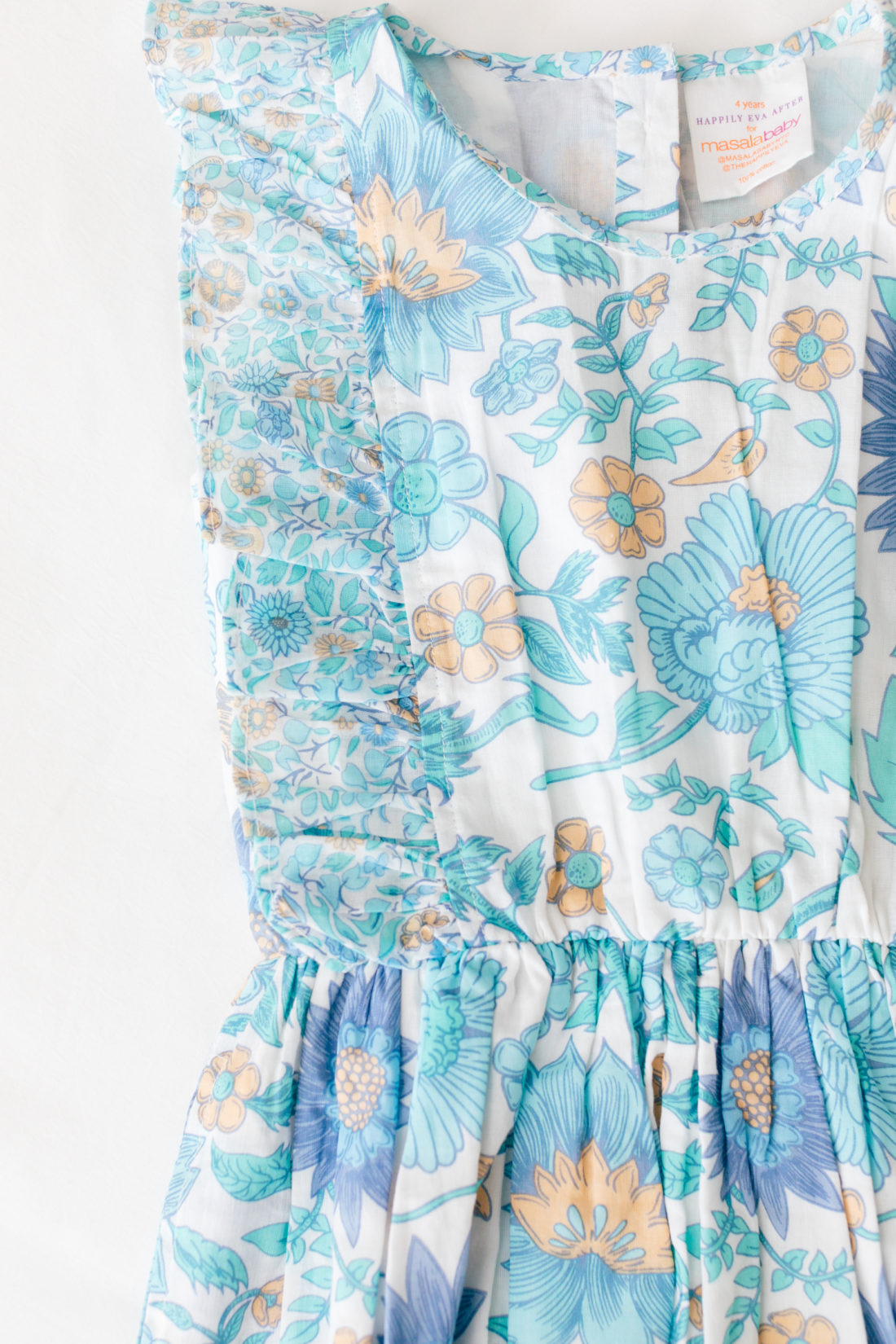 A close up of the detail on the fantasia dress from the Happily Eva After x Masala Baby capsule collection