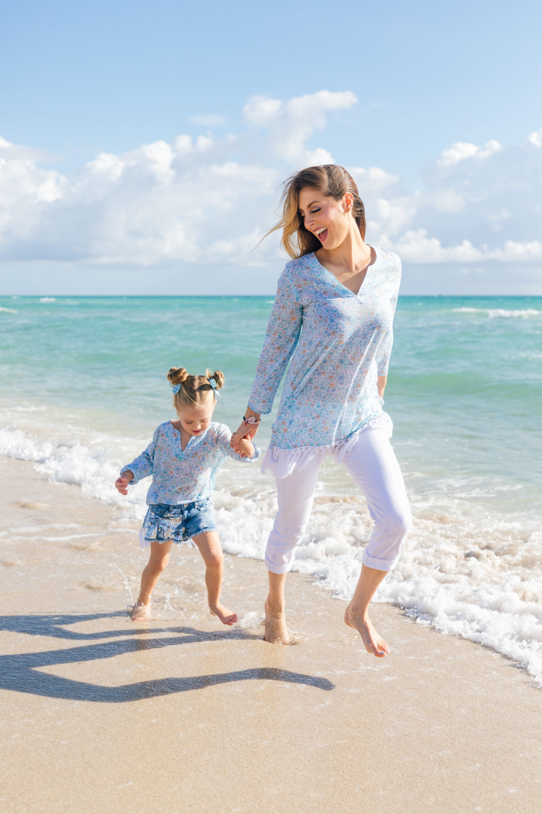 Eva Amurri Martino and Marlowe Martino wear matching Happily Eva After x Masala Baby tunics and run along the water's edge in Miami FL