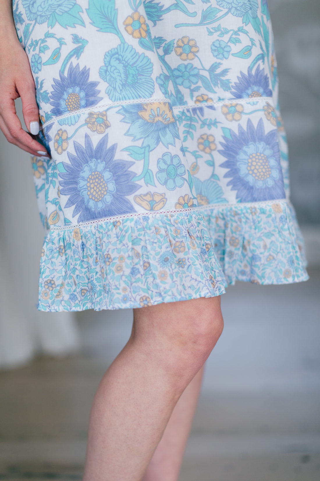 Detail of the bottom of the blue floral dress in the Happily Eva After x Masala Baby capsule collection