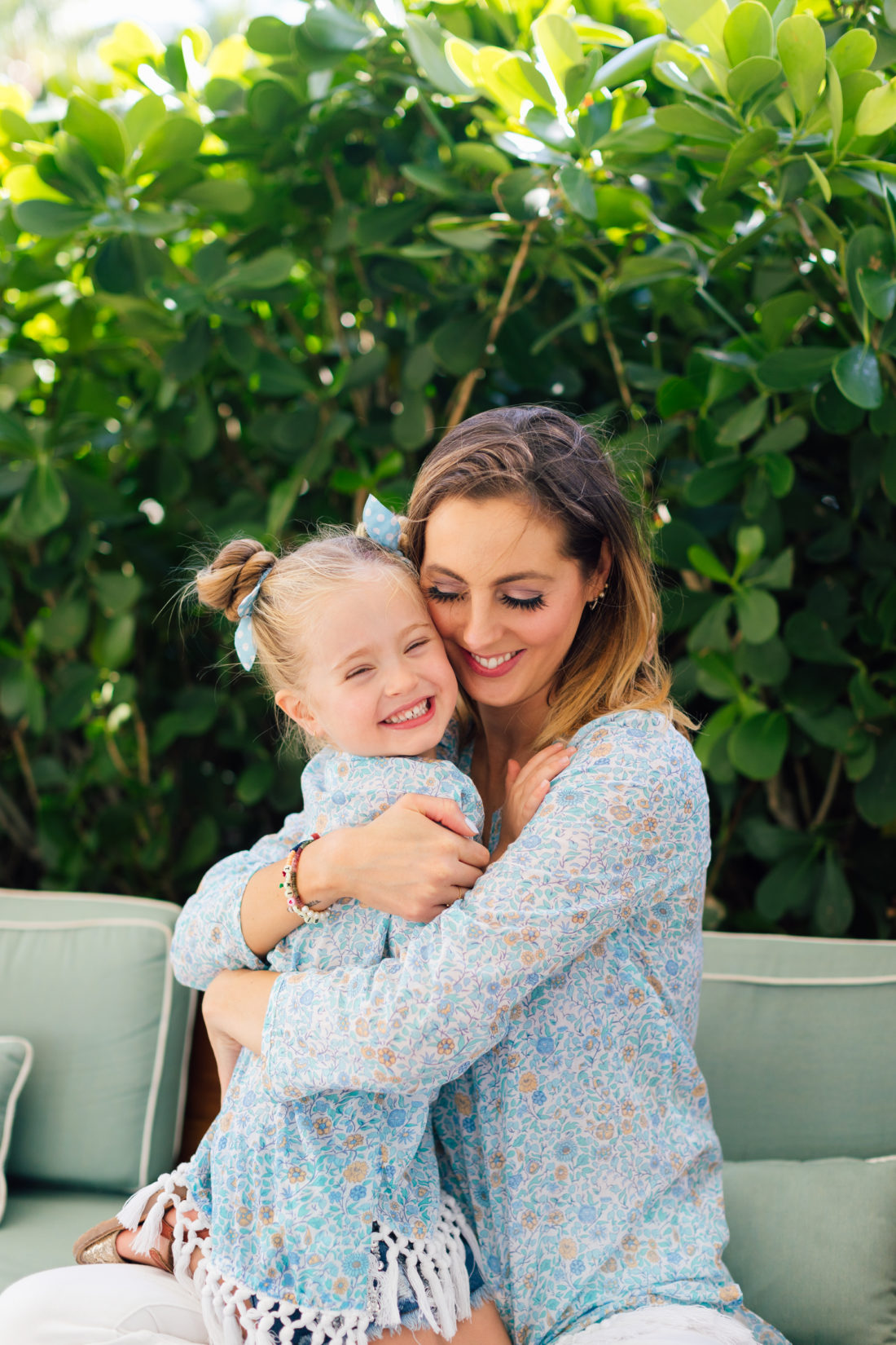 Eva Amurri Martino and Marlowe Martino wear matching masala baby tunics in a blue floral print from their limited capsule collection for the brand.