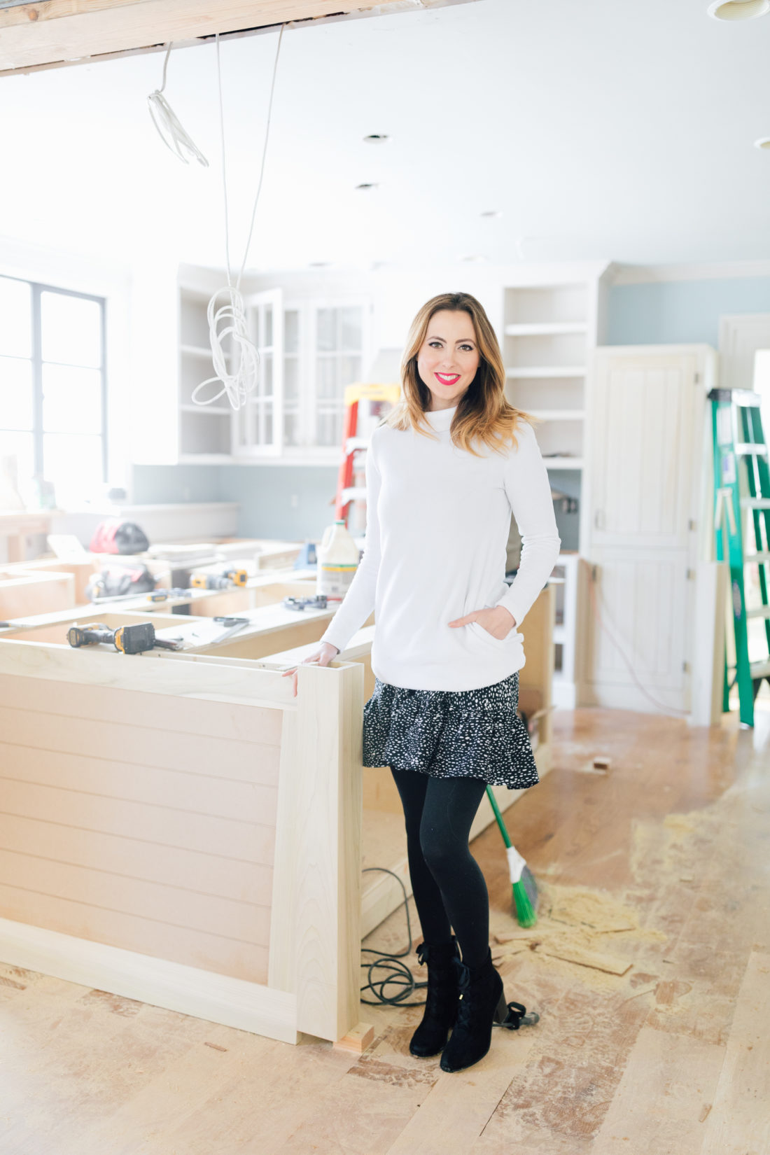 Eva Amurri Martino stands in the living room during her historic home renovation.