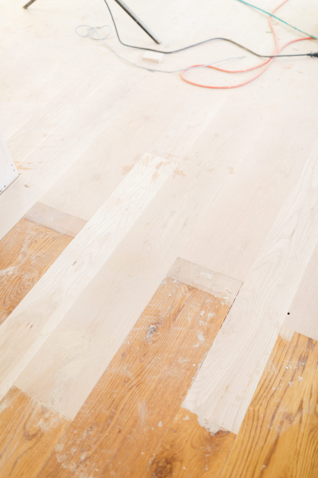 Eva Amurri Martino shows off the new stripped floors during her historic home renovation.