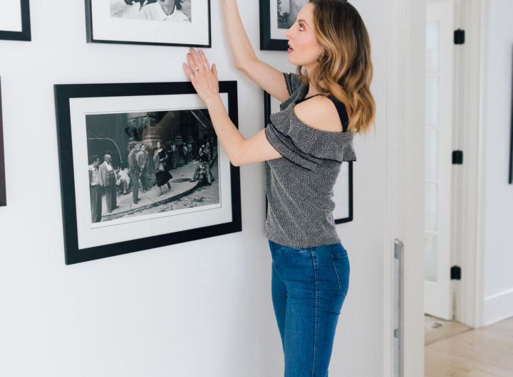 Eva Amurri Martino stands in the hallways of her connecticut home and selects a black and white photograph from the wall as she decides what to pack and what to give away before her family's move