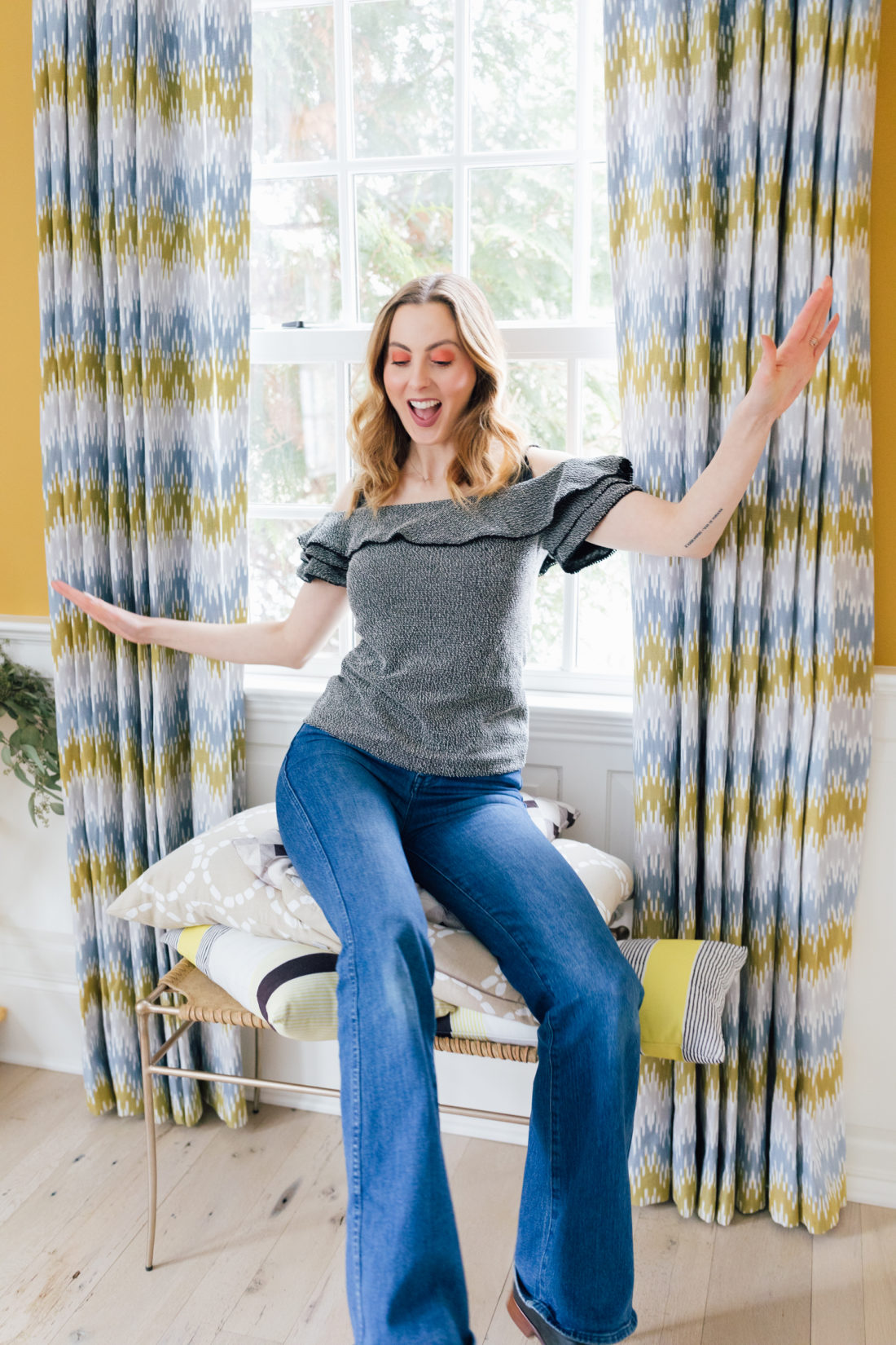 Eva Amurri Martino sits atop a stack of decorative pillows as she prepares to pack up her connecticut home in the days before her family's move