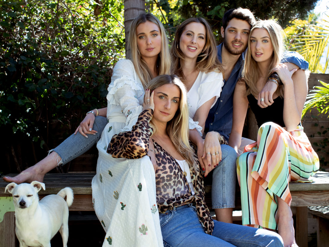 Eva Amurri Martino sits with her sisters and brother on a picnic table at a Venice bungalow