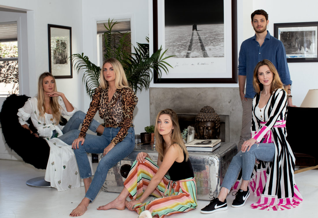 Siblings Ruby Rufus Isaacs, Tallulah Rufus Isaacs, Leone Amurri, Augusta Amurri, and Eva Amurri Martino sit in the living room of a venice bungalow wearing silk We Are Leone clothes