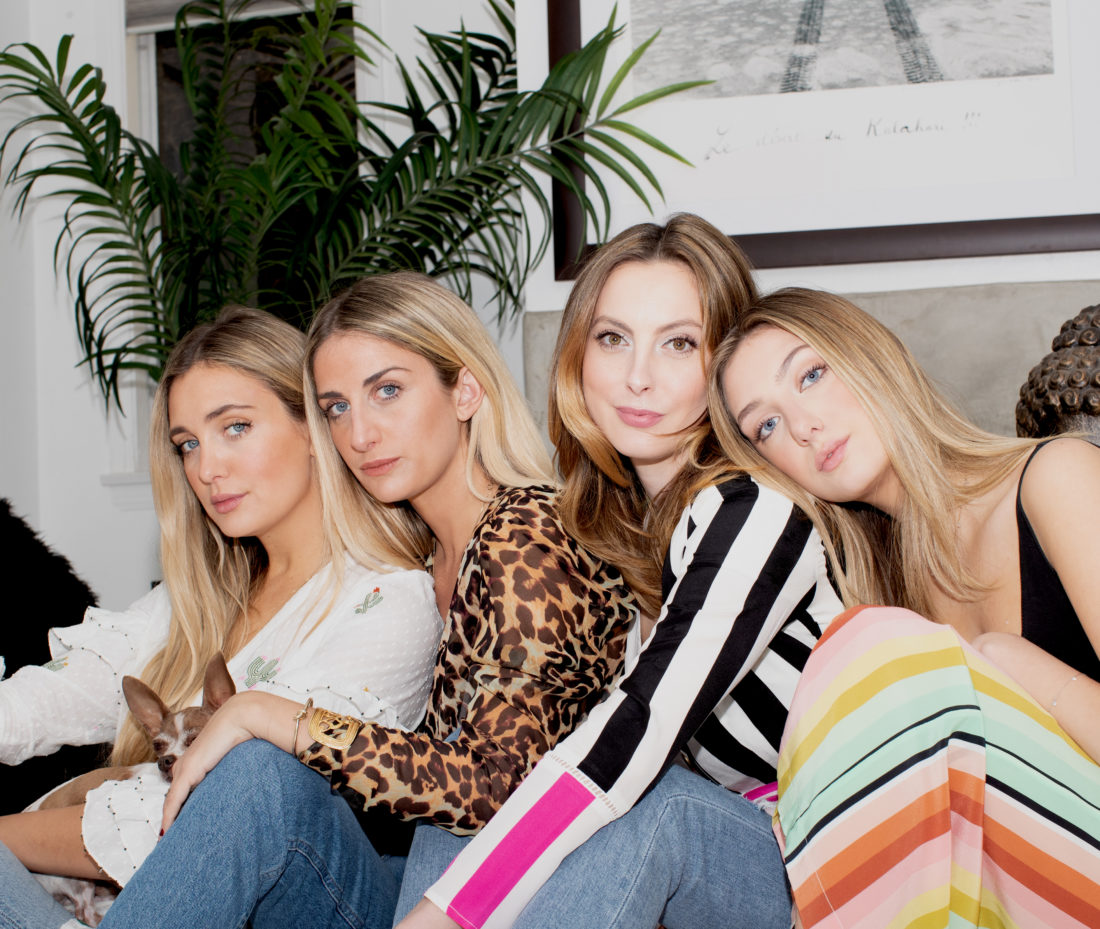 Sisters Ruby Rufus-Isaacs, Tallulah Rufus-Isaacs, Eva Amurri Martino, and Augusta Amurri sit together in the living room of a Venice bungalow wearing We Are Leone silk clothing pieces
