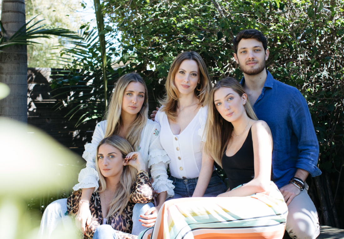 Eva Amurri Martino and her siblings on her father's side sit for a portrait in the garden of a venice bungalow
