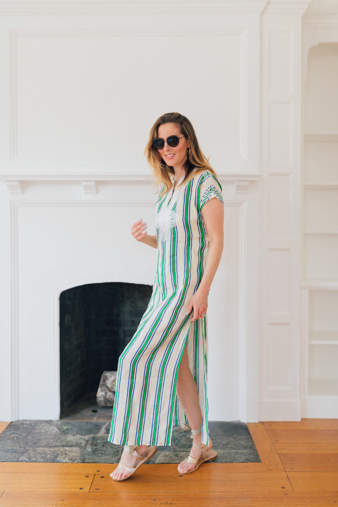 Eva Amurri Martino of Happily Eva After wears a green and white striped dress and shares her Jamaica packing list