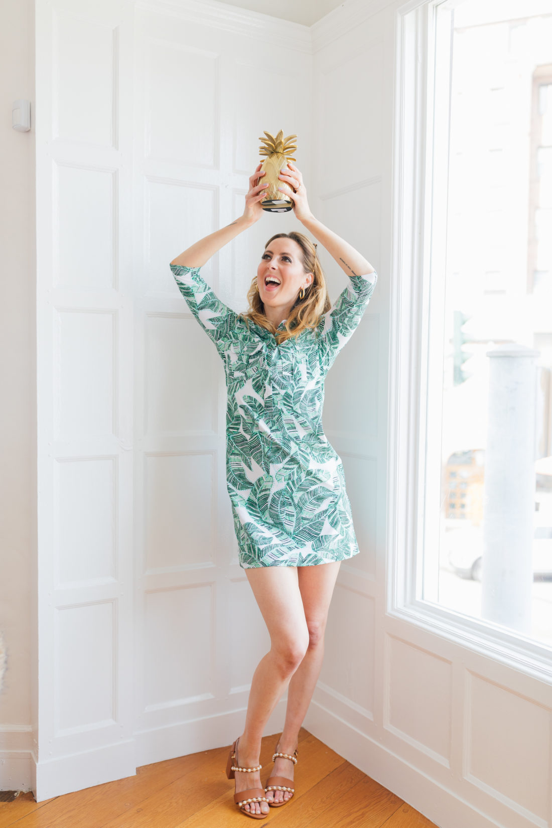Eva Amurri Martino of Happily Eva After wears a green floral dress and shares her Jamaica packing list
