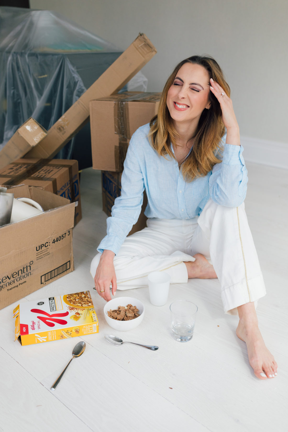 Eva Amurri Martino of Happily Eva After sits on the floor of her newly renovated historic home in Connecticut, enjoying a bowl of Special K