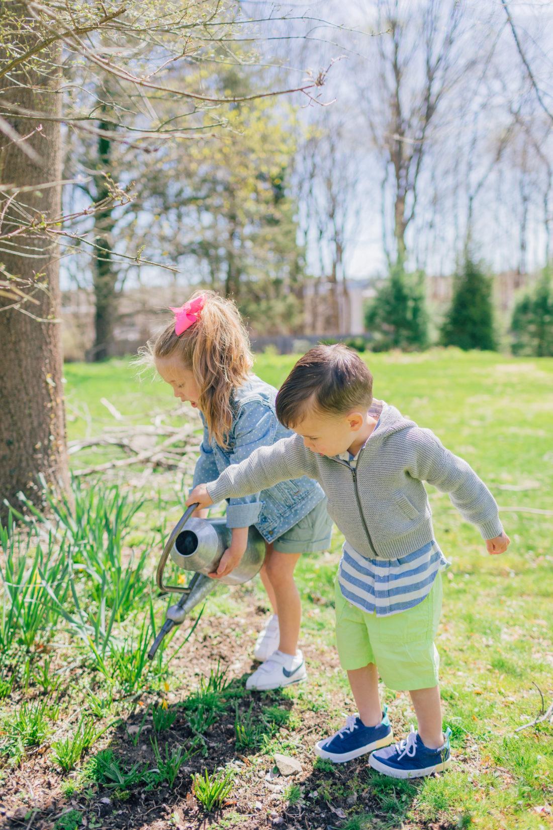 Eva Amurri Martino's daughter Marlowe and son Major water their garden in her spring style picks