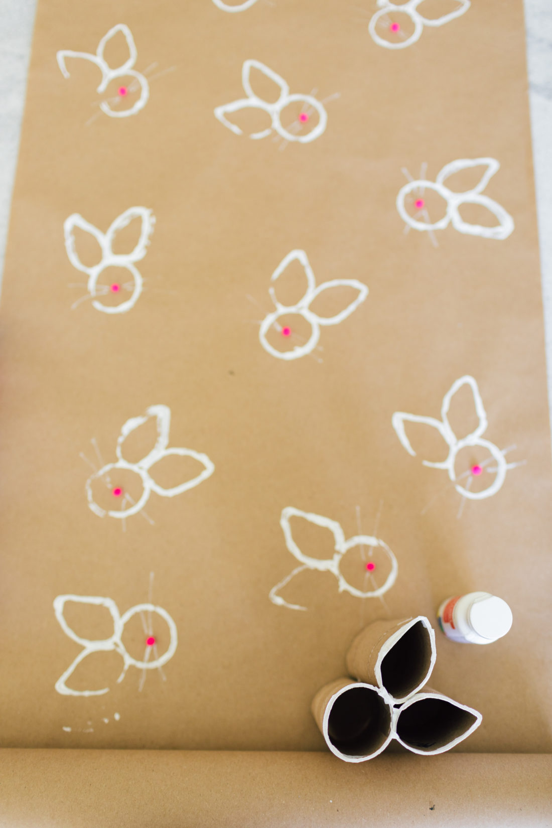 Eva Amurri Martino stamps bunnies onto wrapping paper for Easter