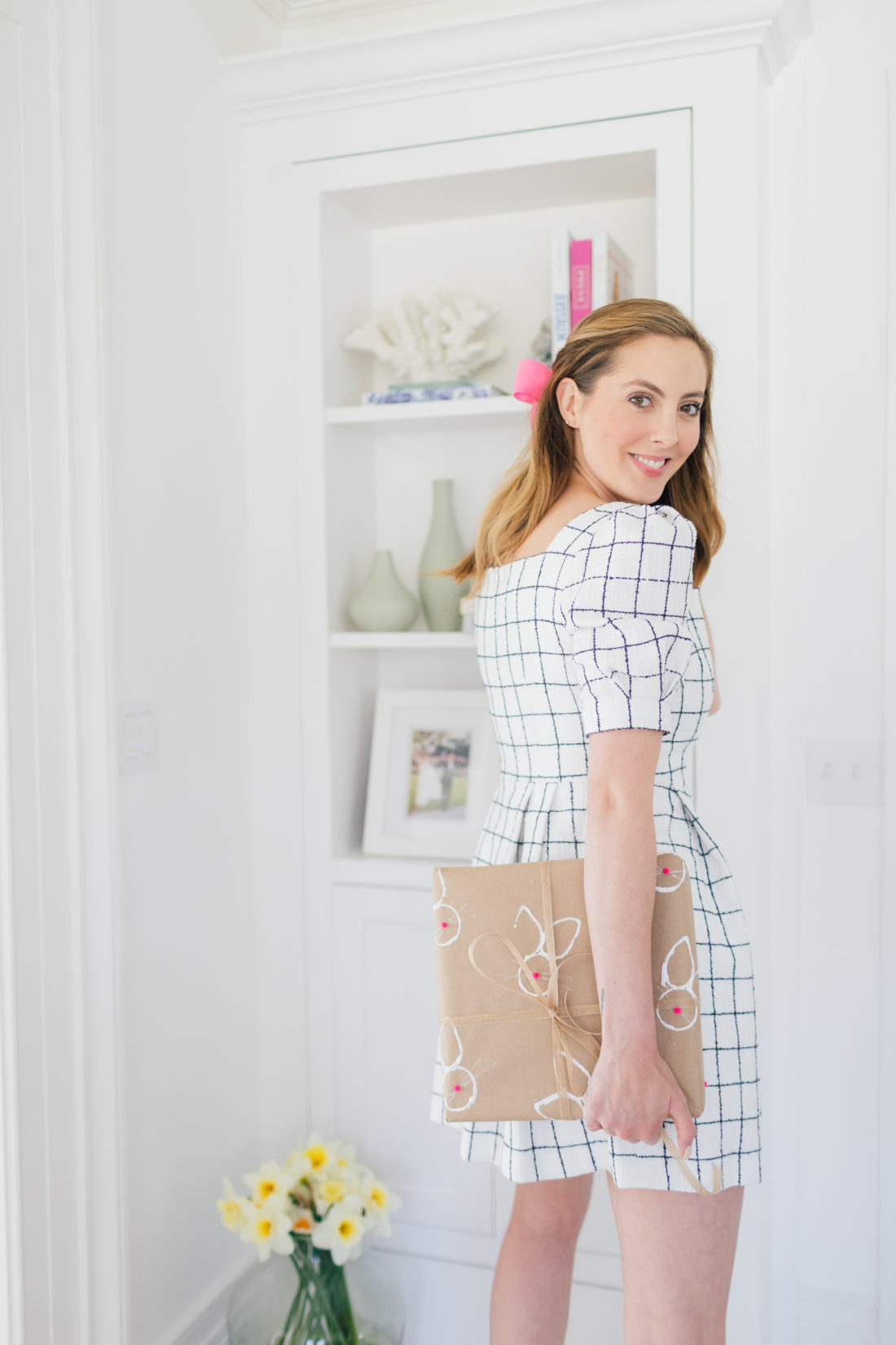 Eva Amurri Martino wraps a gift in stamped Easter wrapping paper