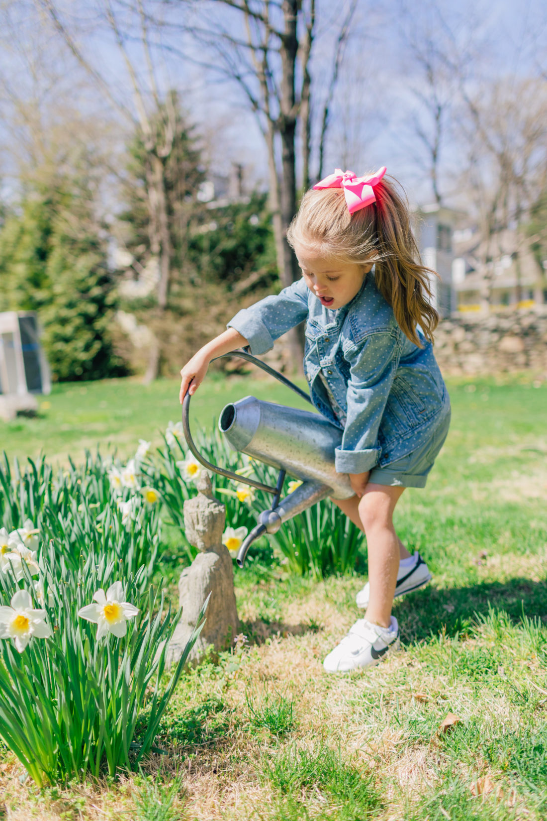 Eva Amurri Martino's daughter Marlowe waters the garden in her spring style picks