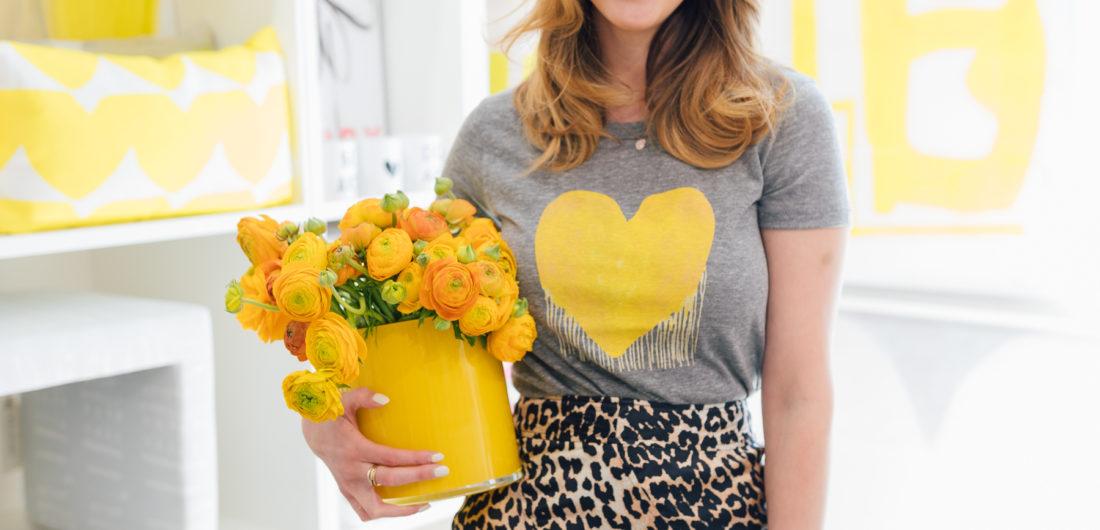 Eva Amurri Martino wears a yellow drippy heart shirt from Kerri Rosenthal and a leopard printed skirt