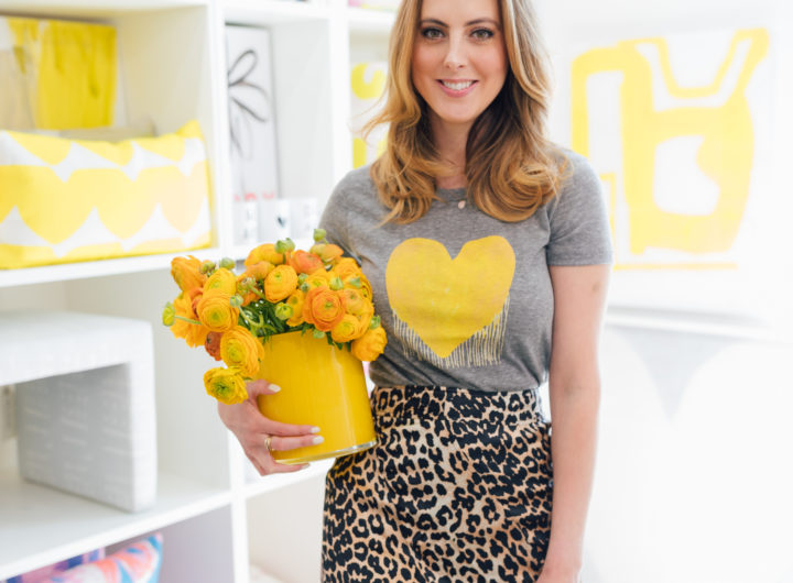 Eva Amurri Martino wears a yellow drippy heart shirt from Kerri Rosenthal and a leopard printed skirt
