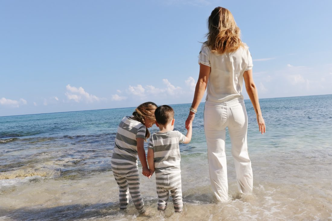 Eva Amurri Martino stands on the beach in Connecticut with her kids Marlowe and Major