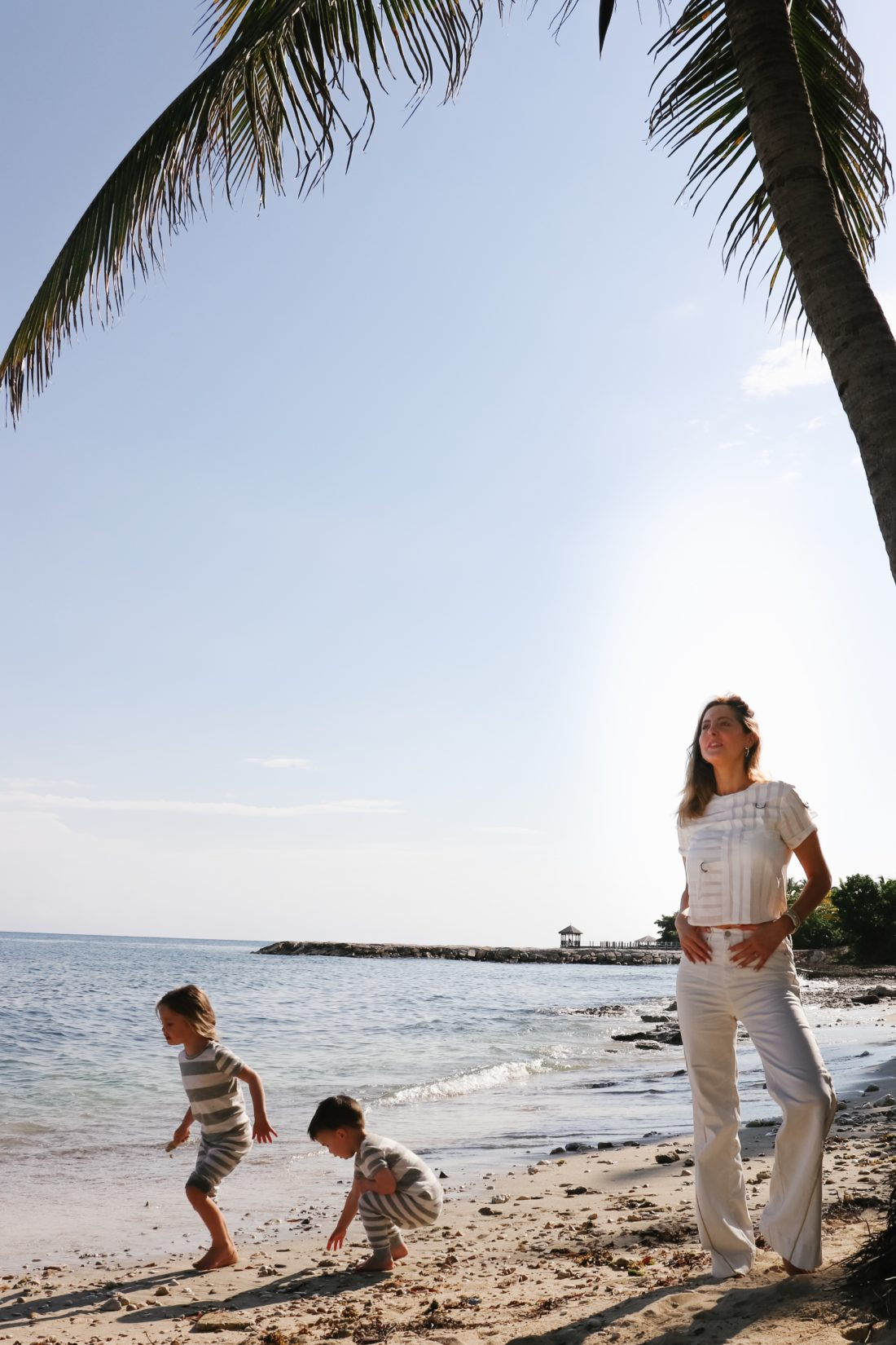 Eva Amurri Martino stands on the beach in Jamaica with her kids Marlowe and Major