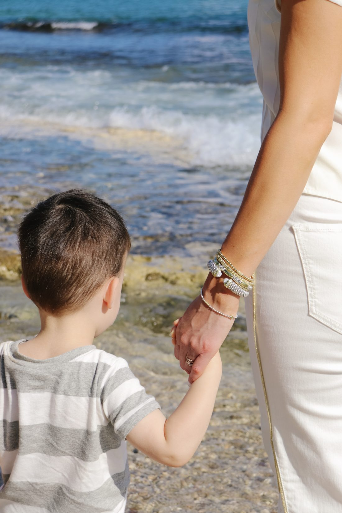 Eva Amurri Martino holds her son Major's hand on the beach in Jamaica