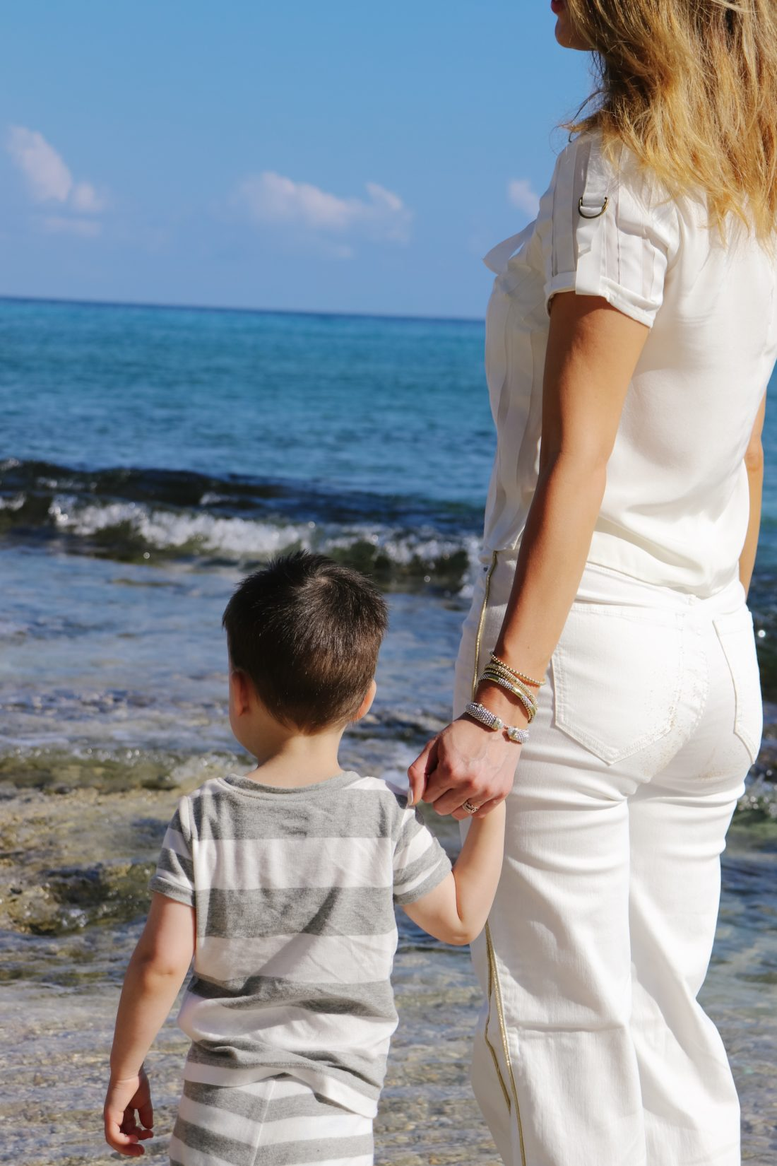 Eva Amurri Martino holds her son Major's hand on the beach in Connecticut
