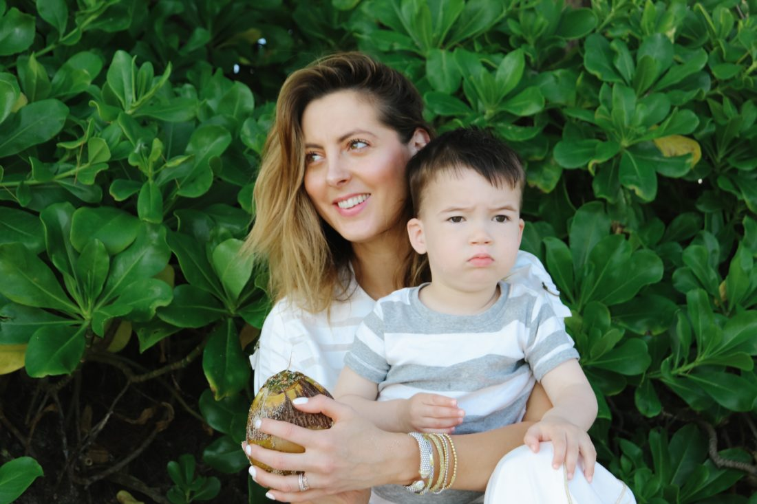 Eva Amurri Martino holds her son Major's hand on the beach in Jamaica