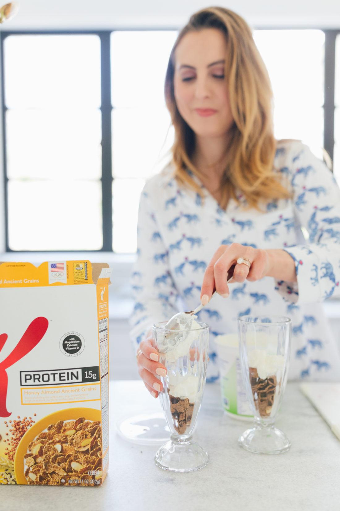 Eva Amurri Martino of Happily Eva After adds yogurt to her parfait