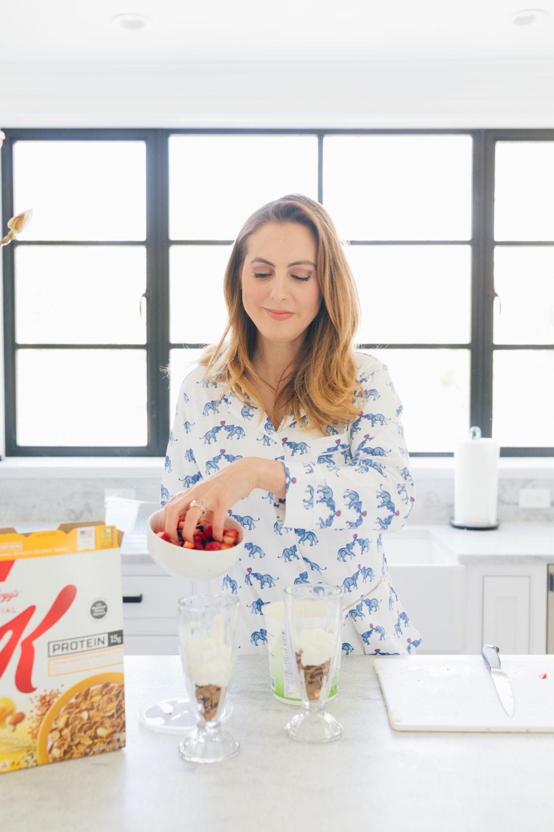 Eva Amurri Martino of Happily Eva After adds some berries to her yogurt parfait