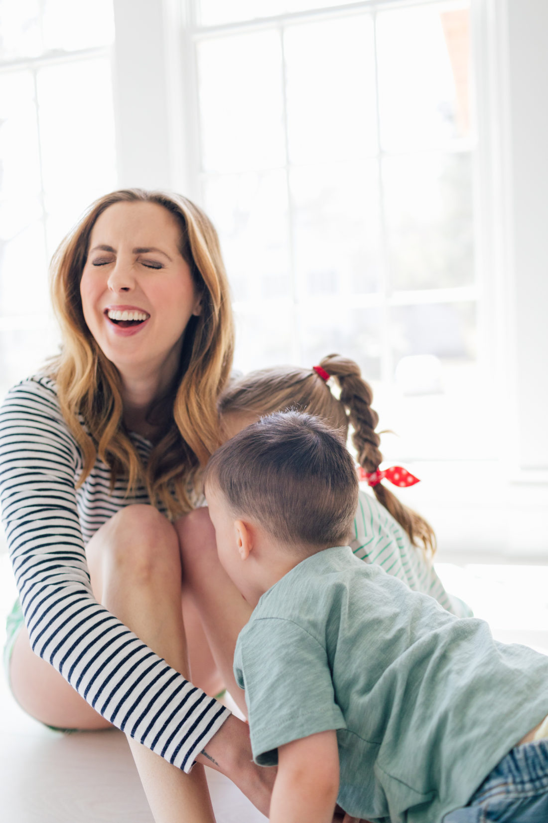Eva Amurri Martino of Happily Eva After plays with her kids Marlowe and Major on the floor of their new home in Connecticut