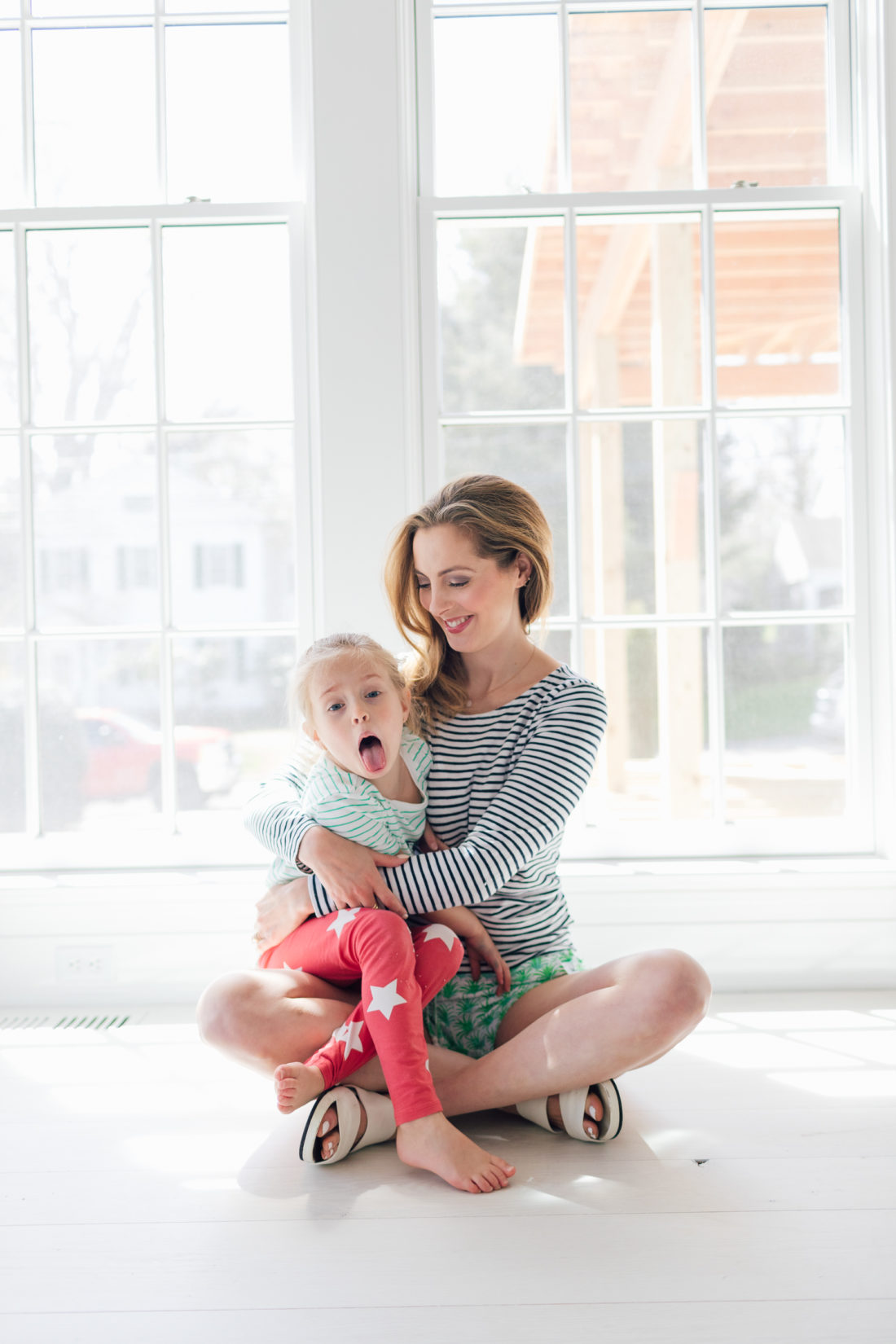 Eva Amurri Martino of Happily Eva After cradles her daughter Marlowe on the floor of their new home in Connecticut